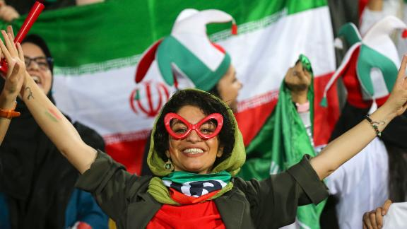 An Iranian woman cheers during the World Cup qualification match between Iran and Cambodia at the Azadi stadium in the capital Tehran on October 10, 2019.