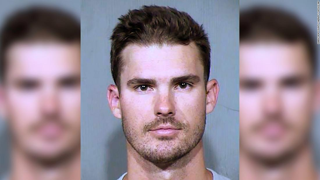 MLB pitcher kicked, tased and arrested after allegedly crawling through the doggy door of a stranger's home