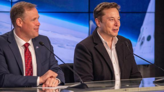 NASA administrator Jim Bridenstine, left, and SpaceX CEO and lead designer Elon Musk address members of the media during a post launch news conference in Kennedy Space Center