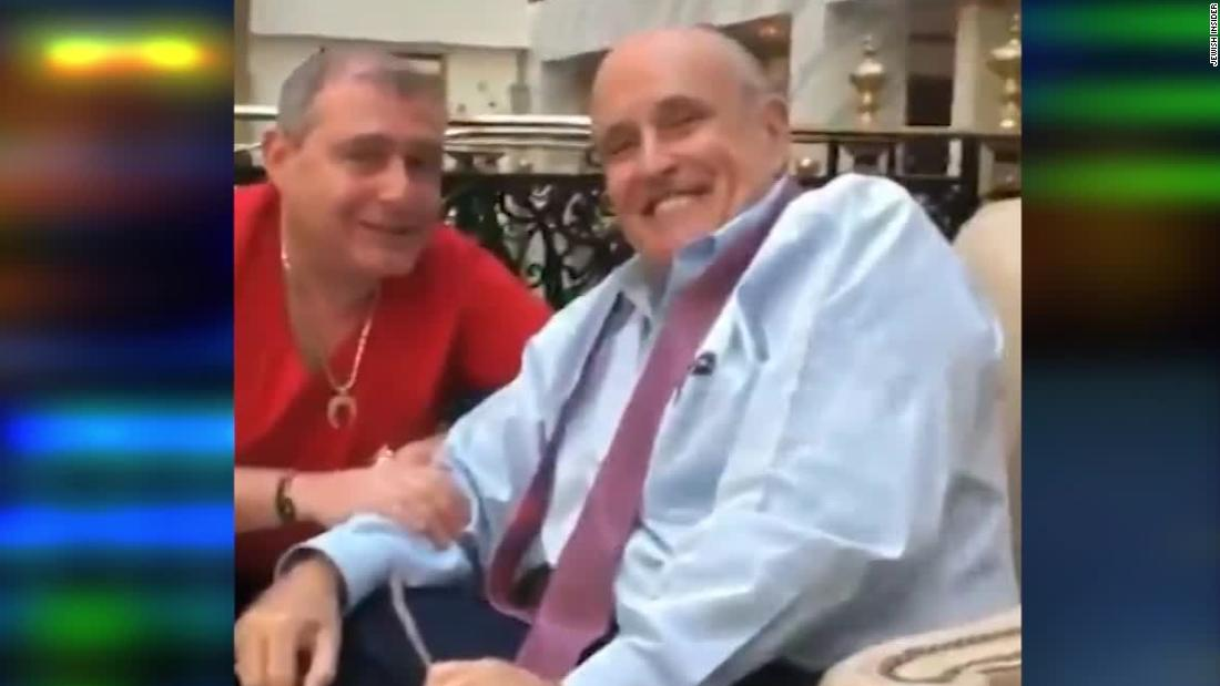 Video shows Rudy Giuliani with arrested associates