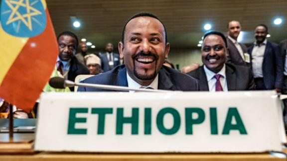 "Ethiopia's Prime Minister Abiy Ahmed (C) smiles before a High Level Consultation Meeting with African leaders on DR Congo election at the AU headquarters in Addis Ababa, on January 17, 2019. - Chairperson of the African Union Commission on January 17, 2019 said ""serious doubts"" remain over the results of last month's election in the DR Congo. (Photo by EDUARDO SOTERAS / AFP)        (Photo credit should read EDUARDO SOTERAS/AFP/Getty Images)"