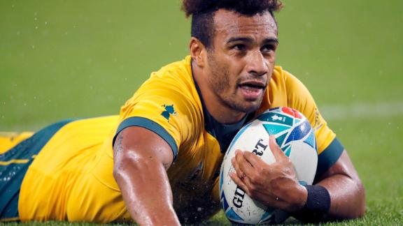 Australia's Will Genia reacts after scoring a try against Georgia.