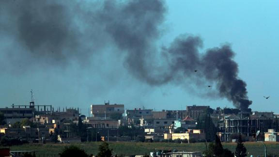Smoke billows from Tal Abyad, Syria, on Friday, October 11.