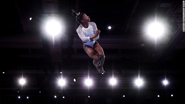 Simone Biles competes in the floor exercise during the World Championships in Stuttgart, Germany, in October 2019