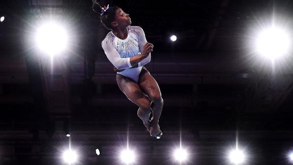 Simone Biles competes in the floor exercise during the World Championships in Stuttgart, Germany, on Thursday, October 10.