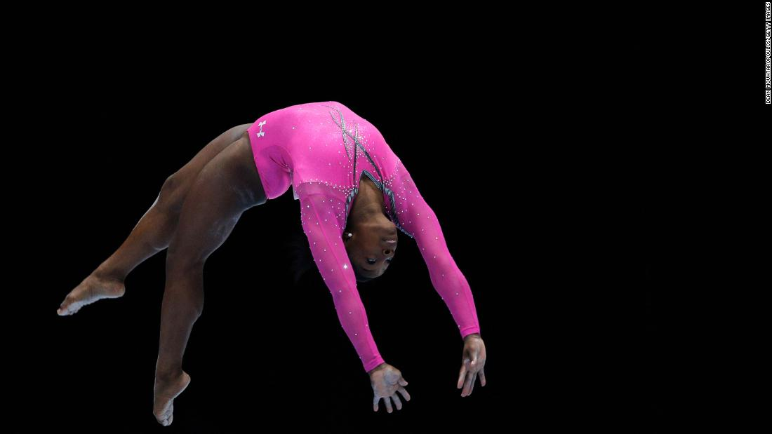 Biles competes in the balance beam final of the 2013 World Championships.