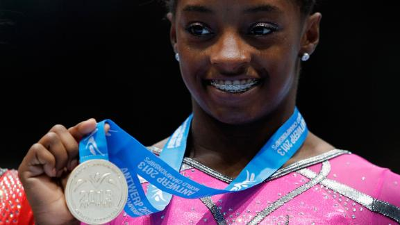 Biles poses after winning the gold medal in the floor exercise at the 2013 World Championships.