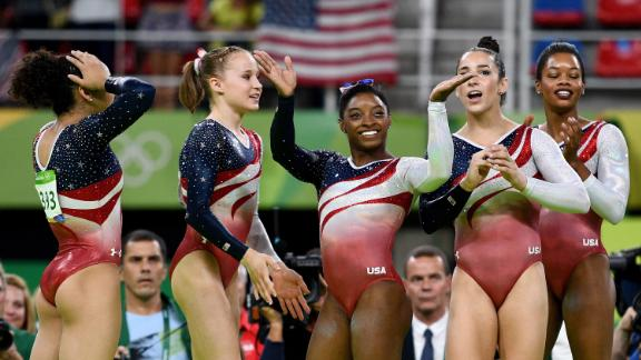 Left to right: Laurie Hernandez, Madison Kocian, Biles, Aly Raisman and Gabby Douglas celebrate winning the gold medal during the artistic gymnastics women's team final of the 2016 Olympics.