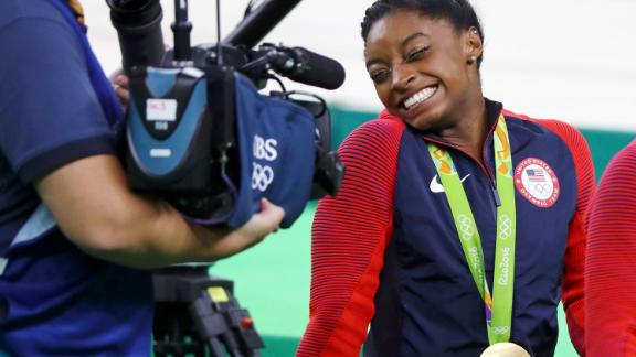 Biles reacts to a camera after winning the women's individual all-around final at the 2016 Olympics.