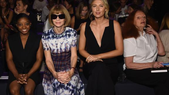 Biles sits with Anna Wintour and Maria Sharapova during New York Fashion Week in September 2016.
