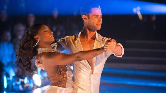 """Biles competes in """"Dancing with the Stars"""" with her partnet Sasha Farber in 2017."""