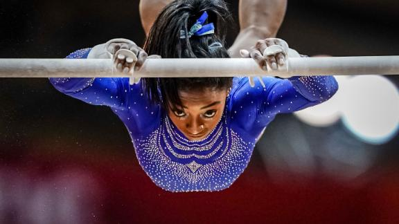 Biles competes on the uneven bars during the 2018 World Championships.