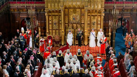 LONDON, ENGLAND - MAY 18:  Queen Elizabeth II prepares to deliver the Queen's Speech from the throne as Prince Philip, Duke of Edinburgh looks on (R) and Prince Charles, Prince of Wales (L) and Camilla, Duchess of Cornwall arrive during State Opening of Parliament in the House of Lords at the Palace of Westminster on May 18, 2016 in London, England. The State Opening of Parliament is the formal start of the parliamentary year. This year's Queen's Speech, setting out the government's agenda for the coming session, is expected to outline policy on prison reform, tuition fee rises and reveal the potential site of a UK spaceport. (Photo by Justin Tallis - WPA Pool/Getty Images)