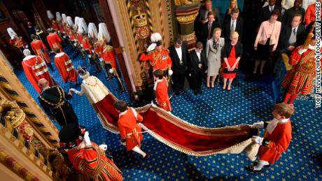 Queen Elizabeth II proceeds through the Royal Gallery before the State Opening of Parliament in 2016.
