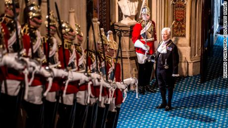 Black Rod waits at the bottom of the stairs before the arrival of Queen Elizabeth II.
