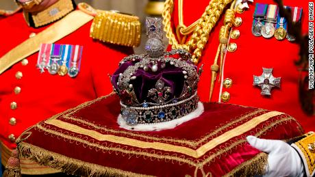 Queen Elizabeth II's Imperial State Crown is carried through Norman Porch ahead of the State Opening of Parliament in 2016.