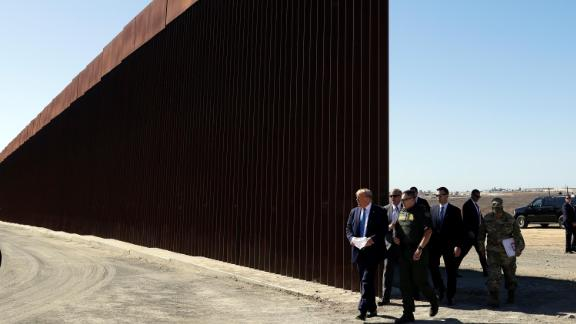 President Donald Trump tours a section of the southern border wall, in September 2019, in Otay Mesa, California.