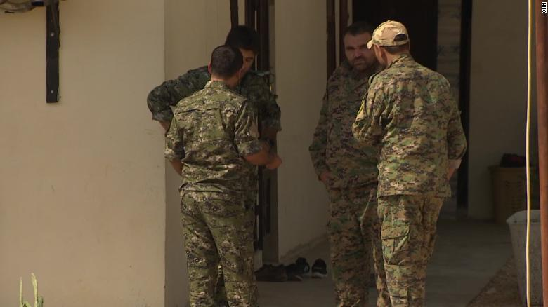 Kurdish forces guard a US base in northern Syria.