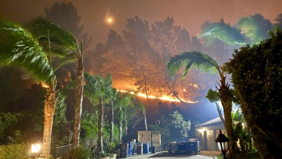 A photo taken by Andro Mammo shows the Porter Ranch neighborhood in Los Angeles engulfed in flames.