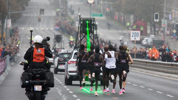 Kipchoge was assisted by an army of 30 pacemakers. A pace car emitted a green laser to help keep time.