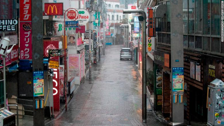 Takeshita street, one of the most crowded and well-known shopping areas in the city, is pictured completely deserted in the Harajuku district of Tokyo.