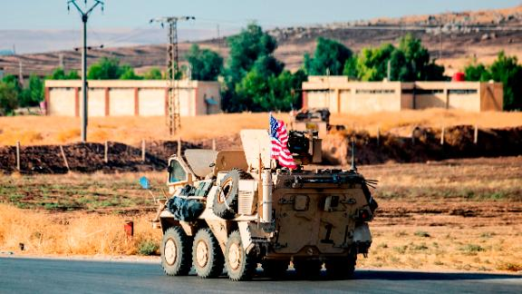 A US military vehicle patrols a road near the town of Tal Baydar in the countryside of Syria's northeastern Hasakeh province on October 12, 2019. - Kurdish forces in northeast Syria Saturday battled a Turkish push along the country's northern border as Ankara's offensive went into its fourth day, following a night of steady advances. Turkey is targeting the Kurdish-led Syrian Democratic Forces (SDF), a key US ally in the five-year battle to crush the Islamic State group. The SDF lost 11,000 fighters in the US-led campaign. (Photo by Delil SOULEIMAN / AFP) (Photo by DELIL SOULEIMAN/AFP via Getty Images)