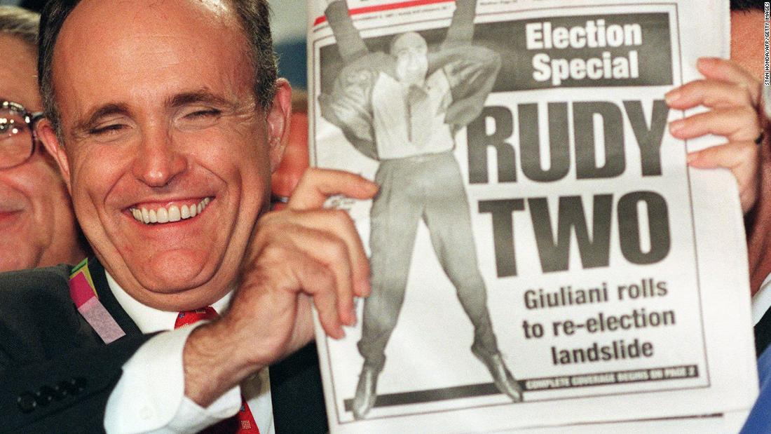 Giuliani celebrates his re-election in 1997. He was widely credited with New York's revitalization during the 1990s, when crime dropped significantly and the economy boomed.