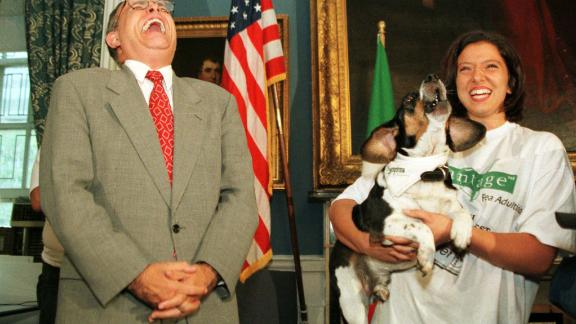 """Giuliani laughs as Regal the beagle sings to Dean Martin's """"That's Amore"""" during a mayoral news conference in September 1997."""