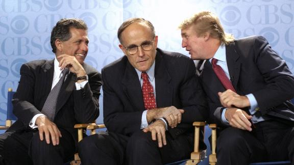 Giuliani is flanked by CBS President Les Moonves, left, and Donald Trump at a news conference in May 1999. CBS was announcing that Bryant Gumbel would be the host of a new morning news program that would air from Trump's International Plaza Building.
