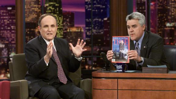 Giuliani is interviewed by talk-show host Jay Leno in January 2002. Leno is holding up the Time magazine that named Giuliani as Person of the Year.