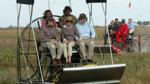 Giuliani, right, and his wife, Judi, tour Florida's Everglades in January 2008. Giuliani dropped out of the presidential race later that month and endorsed US Sen. John McCain.
