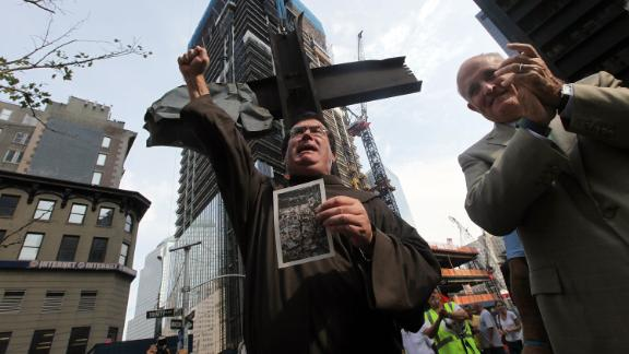 Giuliani joins the Rev. Brian Jordan during a blessing of the World Trade Center cross in July 2011. The cross, which was discovered in the World Trade Center rubble, was being moved into its permanent home at the 9/11 Memorial Museum.
