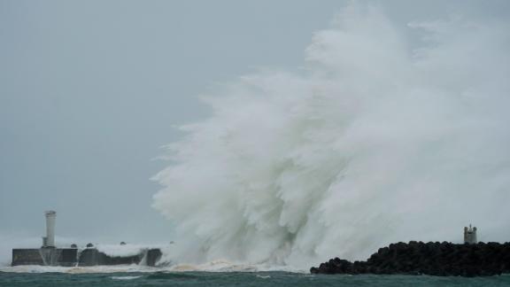 Surging waves hit against the breakwater in Kiho, Japan, on October 12.