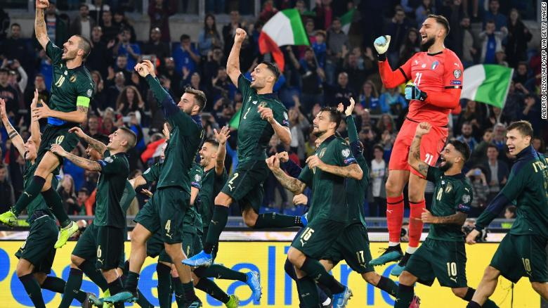 Italy's players celebrate after qualifying for Euro 2020.