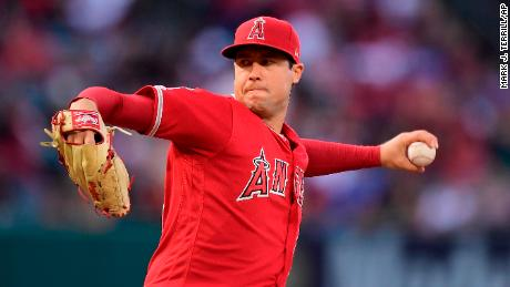 "FILE - In this May 25, 2019, file photo, Los Angeles Angels starting pitcher Tyler Skaggs throws during the first inning of a baseball game against the Texas Rangers in Anaheim, Calif. The Angels say they do not know whether a longtime public relations official had been providing drugs to late pitcher Skaggs, as detailed in a report on ESPN's ""Outside the Lines."" Eric Kay, a 24-year employee of the Angels' PR department, told the Drug Enforcement Agency he had provided opioids to Skaggs and used them with the pitcher for years, according to the ESPN report Saturday, Oct. 12, 2019. Kay reportedly watched as Skaggs snorted three lines of crushed pills in his hotel room in Texas, on the night before he was found dead. (AP Photo/Mark J. Terrill, File)"