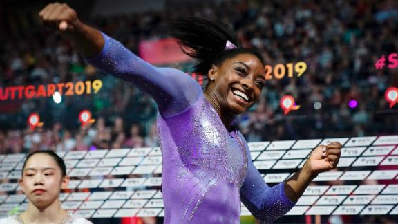 Biles celebrates after winning the beam apparatus final at the 2019 World Championships in Germany. Biles became the most decorated gymnast in the world championships' history with her 24th career medal, 18 of which are gold.