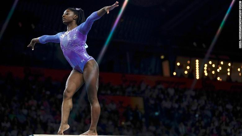 Simone Biles competes on the balance beam at the Artistic Gymnastics World Championships.