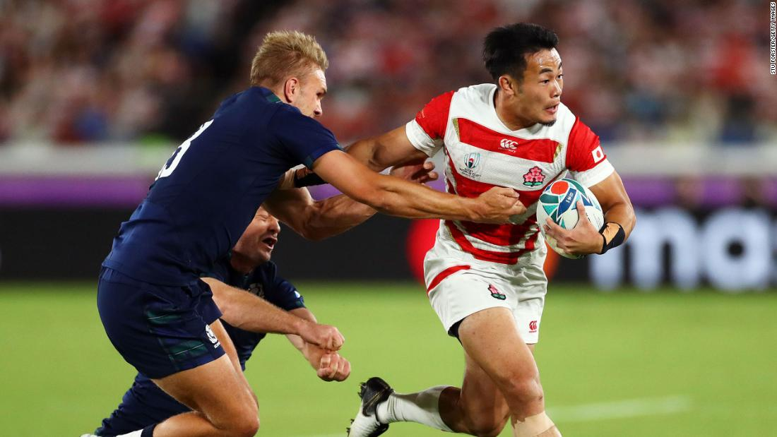 Japan's Kenki Fukuoka evades Scotland's Chris Harris and Greig Laidlaw during the Group A game between Japan and Scotland at International Stadium Yokohama in Yokohama, Japan, on Sunday.