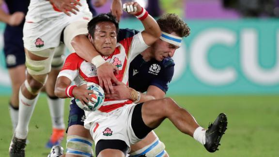 Japan's Yutaka Nagare grabs the ball against Scotland's Jamie Ritchie.