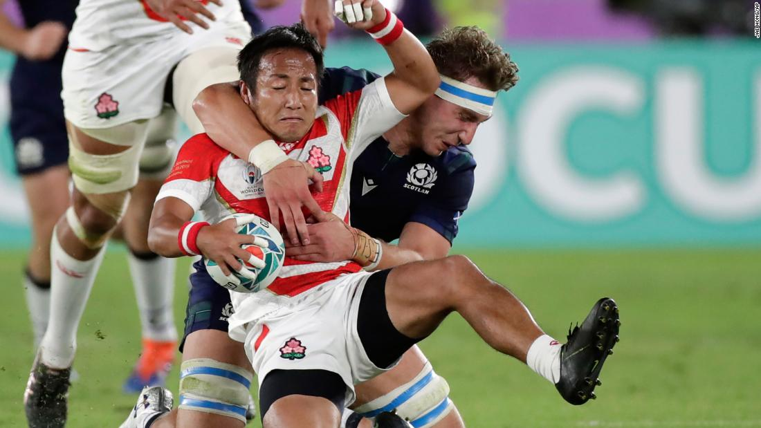 Japan's Yutaka Nagare grabs the ball against Scotland's Jamie Ritchie.