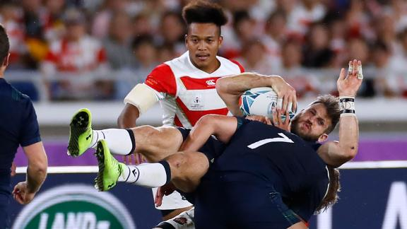 Scotland's wing Tommy Seymour is tackled. Japan beat Scotland 28-21 on home soil to reach their first ever World Cup quarterfinal.