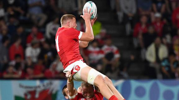 Wales' back row James Davies catches the ball above back row Ross Moriarty during the Pool D match between Wales and Uruguay at the Kumamoto Stadium in Kumamoto, Japan, on Sunday.