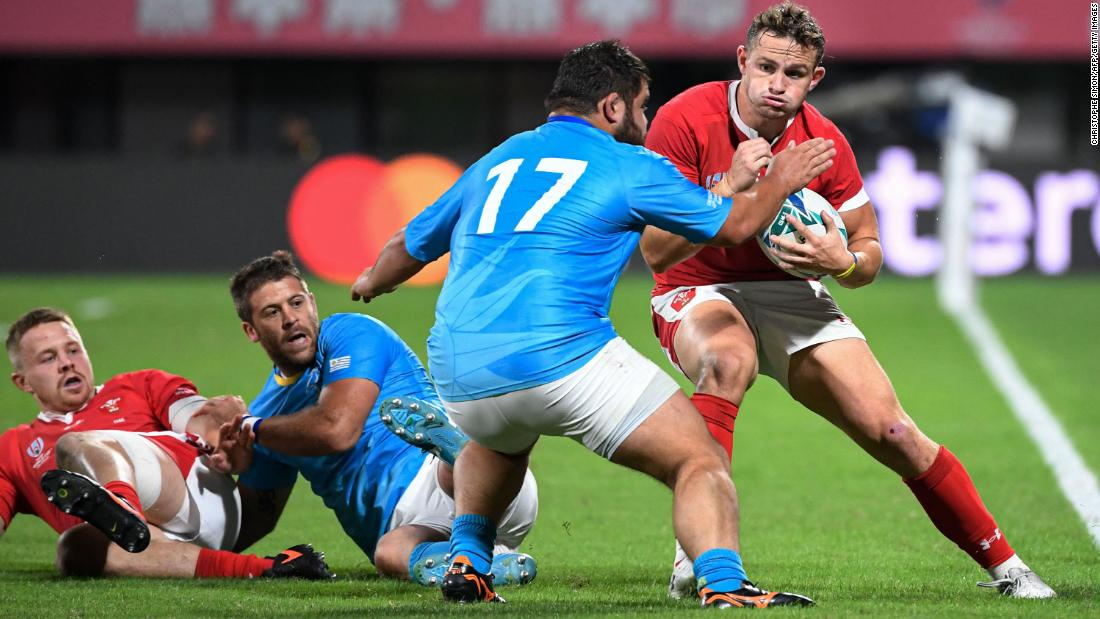 Wales winger Hallam Amos runs with the ball as Uruguay's prop Juan Echeverria goes to tackle.