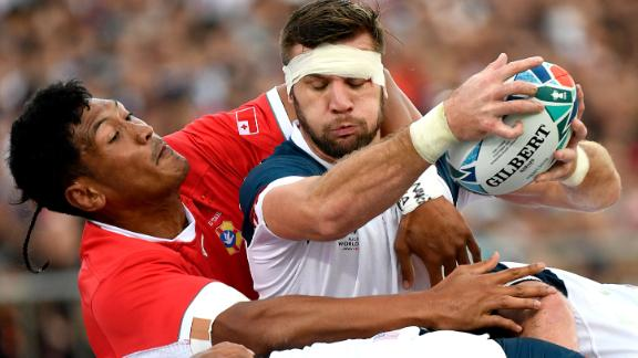 United States' Cam Dolan catches the ball. The United States led the game 12-7 at half-time.
