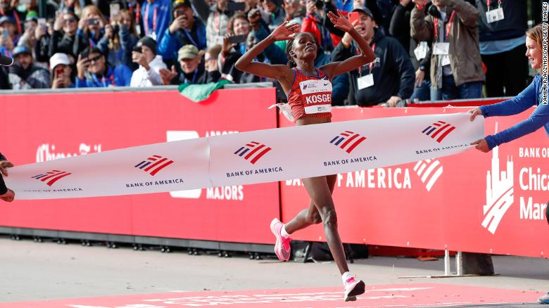 Kenya's Brigid Kosgei crosses the finish line at the Chicago Marathon.