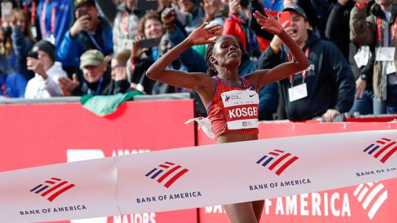 Brigid Kosgei crosses the finish line at the Chicago Marathon with a world record time.