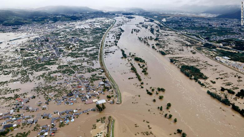 Residential areas are submerged in muddy waters after an embankment of the Chikuma River broke in Nagano, Japan, on October 13.