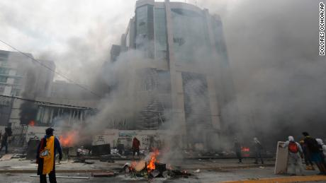 The national auditor's office building burns during clashes between anti-government demonstrators and police in the capital.