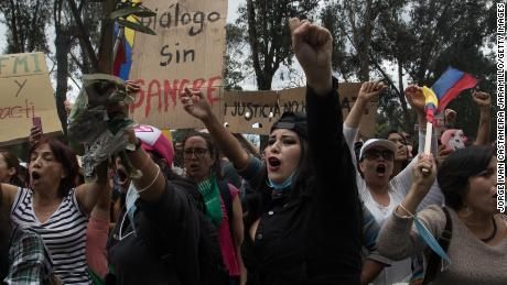 Women march through Quito to demand economic measures taken by Ecuador's President are repealed.