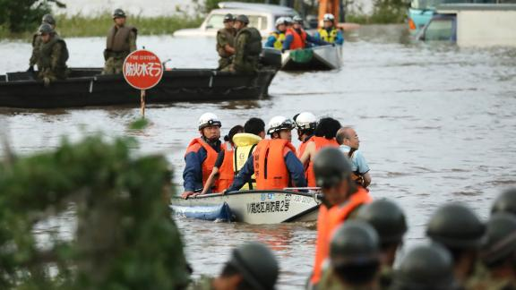 Fire department workers evacuate residents from a flooded area in Kawagoe, Japan, on October 13.